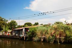 thai house near river or canal - stock photo