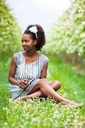 Outdoor portrait of a young beautiful african american woman - black people Stock Photos
