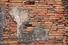 vintage brick wall with cracked concrete - stock photo