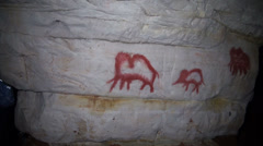Wall paintings in the underground cave. Stock Footage