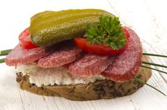 salami bread with gherkin - stock photo