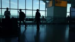 Airport departure gate, silhouette people Stock Footage