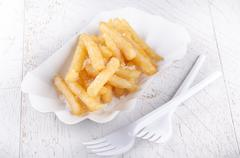French fries and white paperboard container Stock Photos