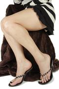 Woman  wearing heels and dress over white background Stock Photos