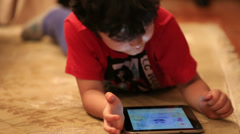 Little cute kid using digital tablet Stock Footage