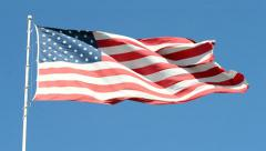 American flag on the blue sky in sunny day, Stock Footage