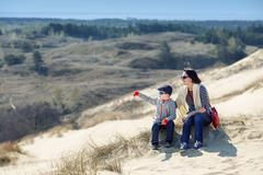 Mother and son together on sand Dunes in Neringa Stock Photos