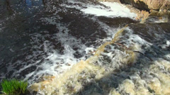 Waterfall in rocky shore Stock Footage