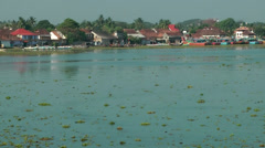 India Kerala Kochi Cochin City 001 simply houses in the backwaters - stock footage