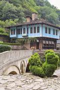 Old house and a stone bridge in the architectural complex Etara, Stock Photos