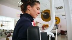 The girl on the machine at the gym. Stock Footage