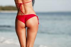 Sexy woman back on sea background Stock Photos