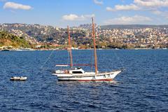 Two masted wooden sailing boat cruising into Bosphorus Stock Photos