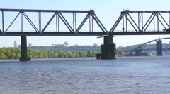 Special wagon of train moves across the river over the bridge. Stock Footage