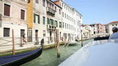 taxi-boat riding on canal through the island of venice - stock footage