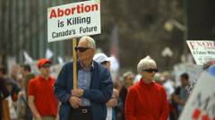 Pro Life Protestors - Elderly Couple Protesting on Parliament Hill Canada - stock footage