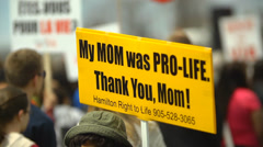 Stock Video Footage of Pro Life Anti Abortion Protestors - Mom Sign