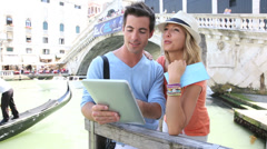 couple in venice standing in front of the rialto bridge - stock footage