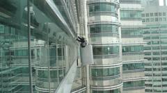Repairman on a skyscraper - stock footage
