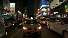 Taxi in Times Square at Night in Slow Motion in 4K Stock Footage