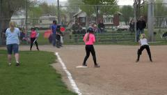 Girls softball game hit run to first base HD 051 Stock Footage