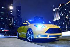 Performance yellow car in downtown chicago. fast and furious. car at night - Stock Photos