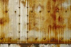 rusty metal with rivets photo background. nasty backgrounds collection. - stock photo