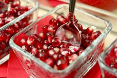 Tasteful fresh pomegranate seeds serving in a glass bowls. fruits photo colle Stock Photos