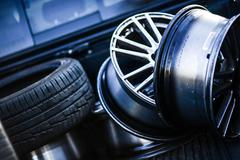 Low profile tires and rims in the garage. transportation photo collection. Stock Photos
