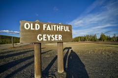 Old faithful geyser wood sign - famous old faithful geyser in the yellowstone Stock Photos