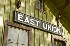 east union wood sign - east union, il train station sign. - stock photo