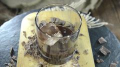chocolate liqueur (loopable) - stock footage