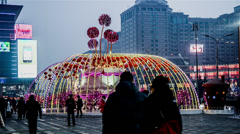 The night view of Glory plaza with pedestrians and lights in Beijing, China Stock Footage