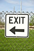 Exit sign on the fence. black arrow showing the right way to exit. signage ph Stock Photos