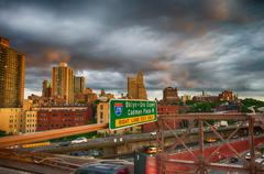 New York City. Terrific sunset view from Brooklyn Bridge with Sk Stock Photos