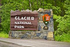 glacier n.p. entrance sign. glacier national park, montana, usa. - stock photo