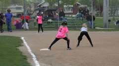 Hit safe at first base girls softball HD 056 Stock Footage