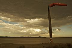 windy mojave desert - wind check pole at dry lakebed. california, usa - stock photo