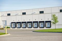 Truck delivery gates in the warehouse. business park photo. business photo co Stock Photos