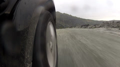 The wheel of the machine rolls on gravel, Stock Footage