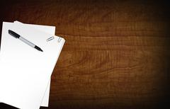 blank papers on wood desk. black marker. copy space composition - stock illustration