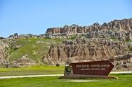 Stock Photo of ben reifel visitor center sign in badlands national park. badlands landscape