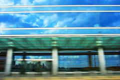 City rush - fast downtown drive. motion blurred glassy building. Stock Photos