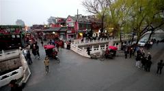 The pedestrians pass over  Yinding Bridgeat sunset Stock Footage