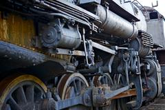 ruined vintage steam locomotive. dusty corroded iron elements of the locomoti - stock photo