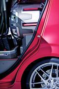Insane subwoofer inside compact car - closeup photo. car audio technology pho Stock Photos