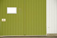 Green siding wall with empty sign. Stock Photos