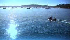 Shimmering Blue Water, Boat with People Stock Footage