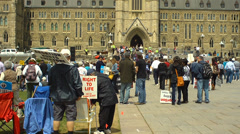 Pro Life Anti Abortion Protestors - Tilt to peace tower - stock footage
