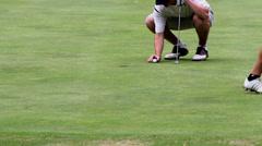 Golfer shoes putt ball Stock Footage